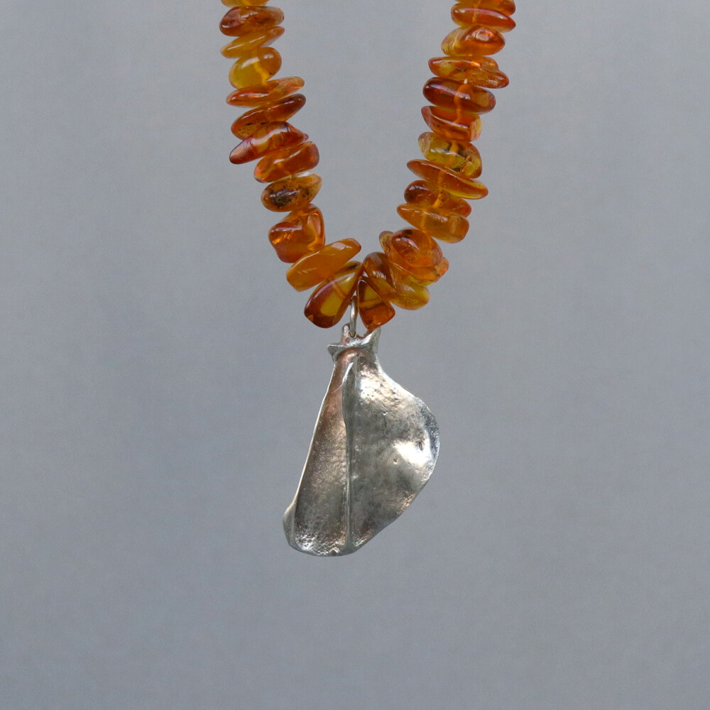Melanie Decourcey/Beaded Necklace/Amber and Silver Bone Pendant