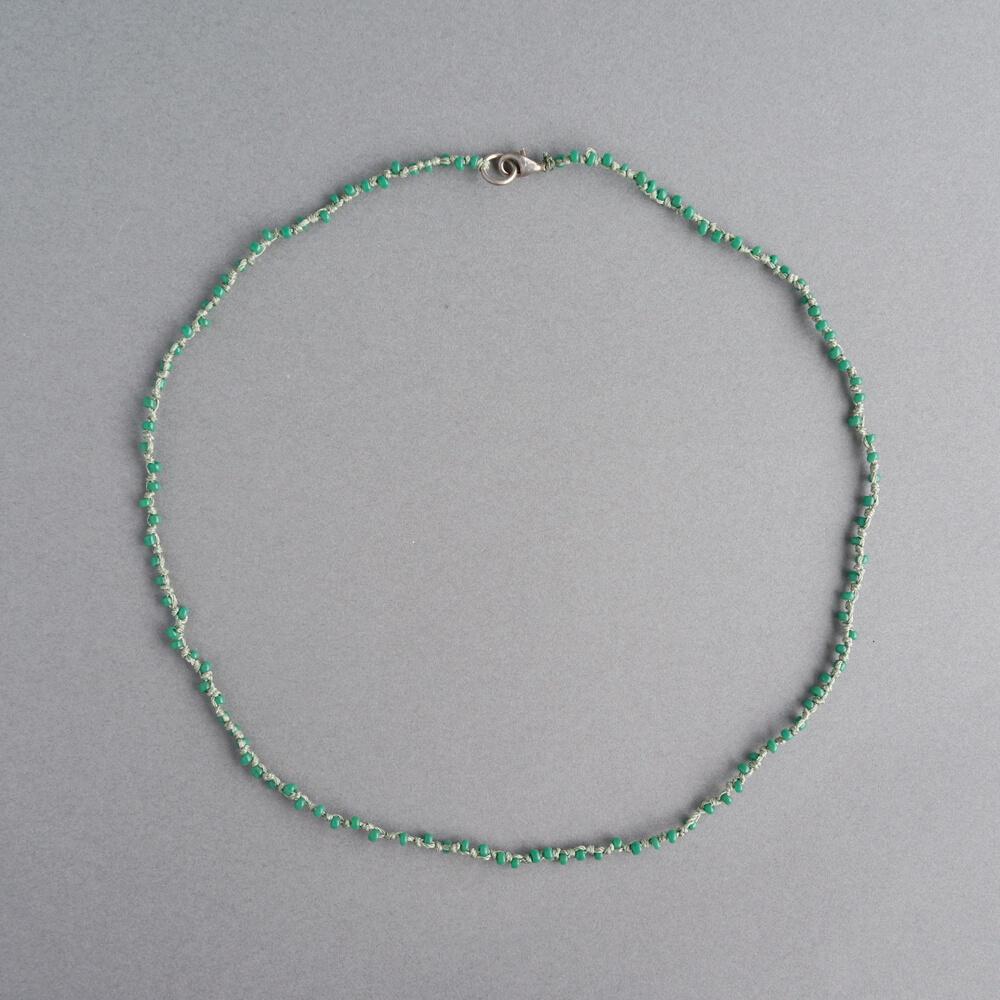 Melanie Decourcey/Beaded glass  bead strands long