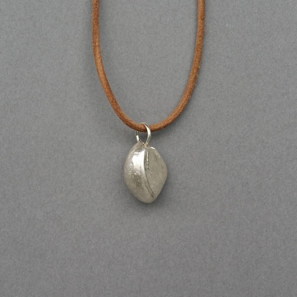 Melanie Decourcey / Beechnut silver pendant on leather