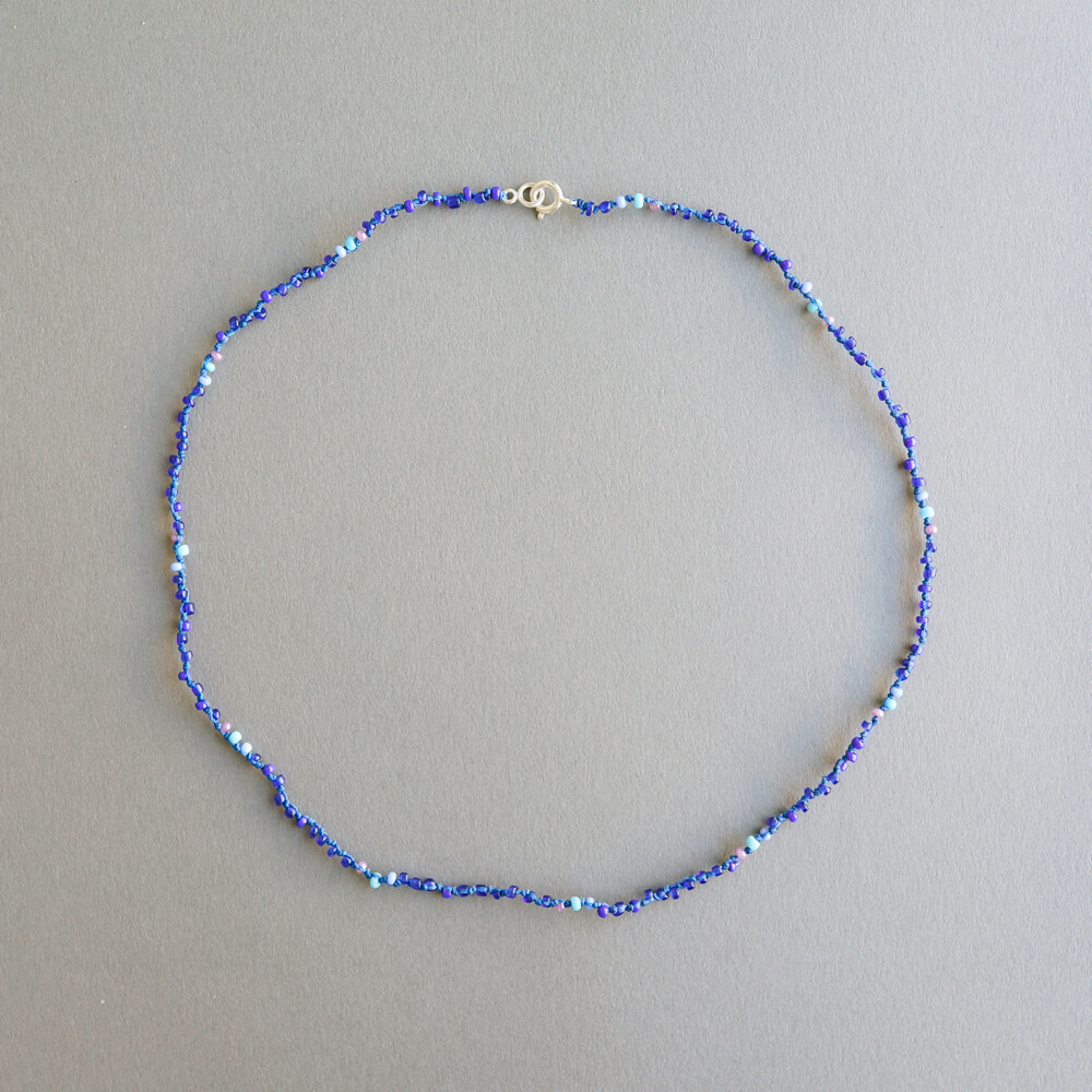Melanie Decourcey/Multi colored beaded glass bead strands long blue