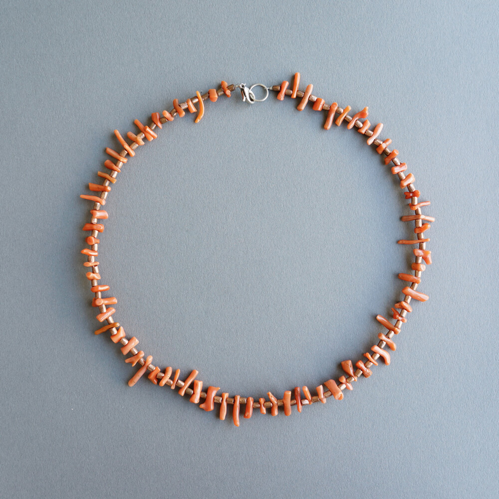 Melanie Decourcey / Coral+copper beaded necklace