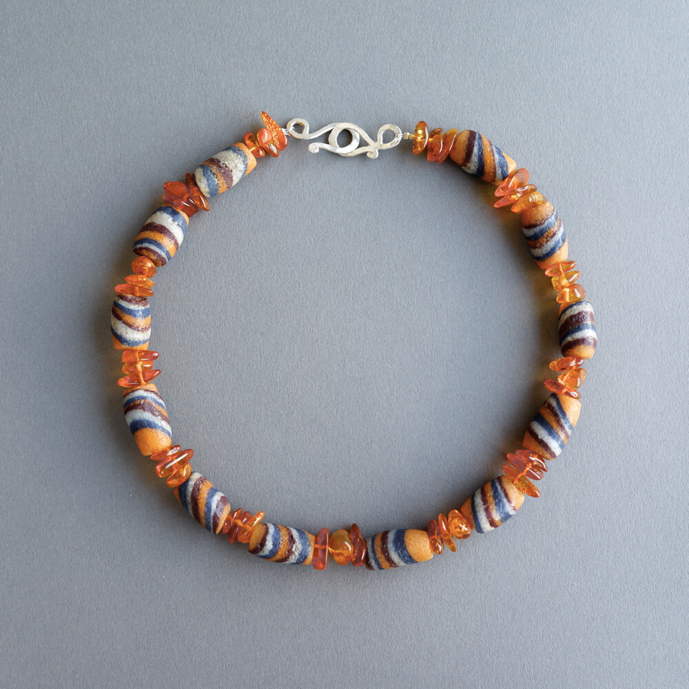 Melanie Decourcey/Amber necklace mixed with African glass beads