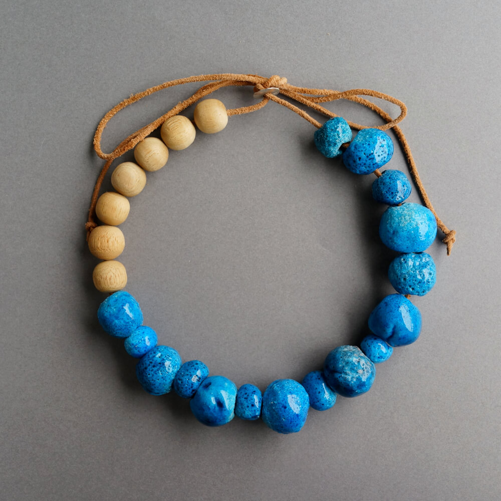 Melanie Decourcey/Ceramic And Wood Beads On Leather