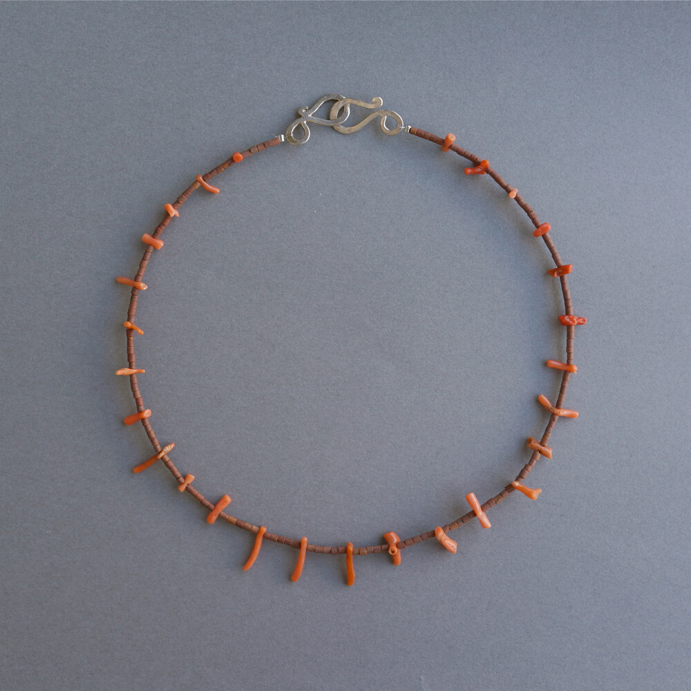 Melanie Decourcey/Beaded Necklace/Coral with African terracotta beads
