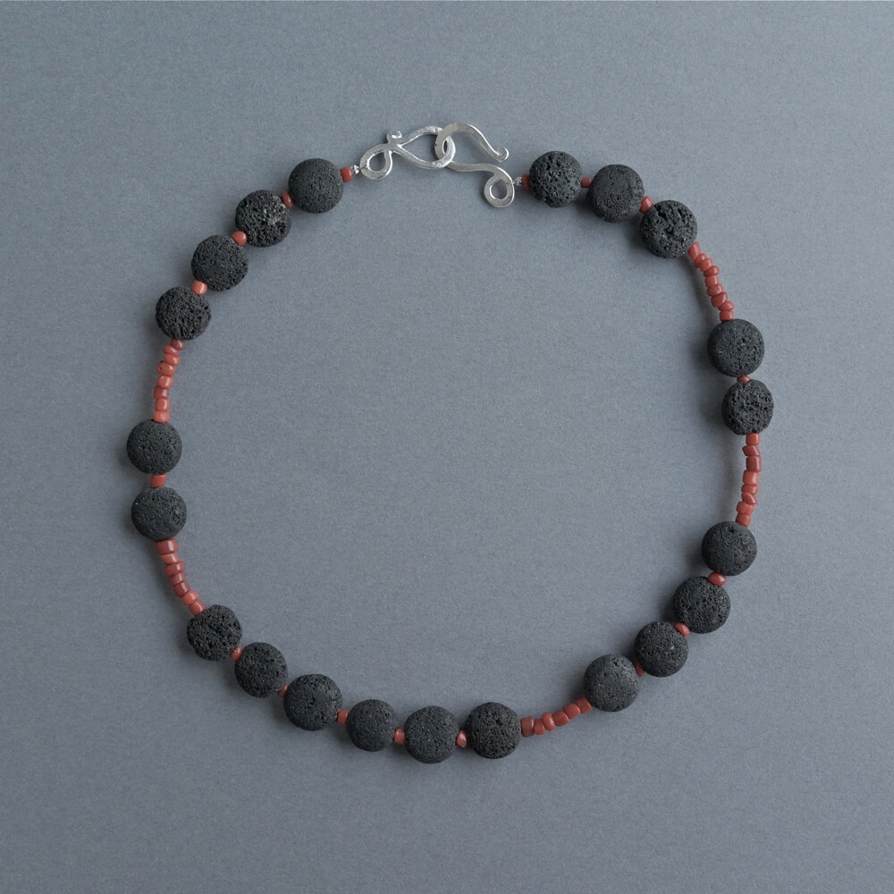 Melanie Decourcey/Beaded Necklace/Lava stone mixed with Tibetan coral beads
