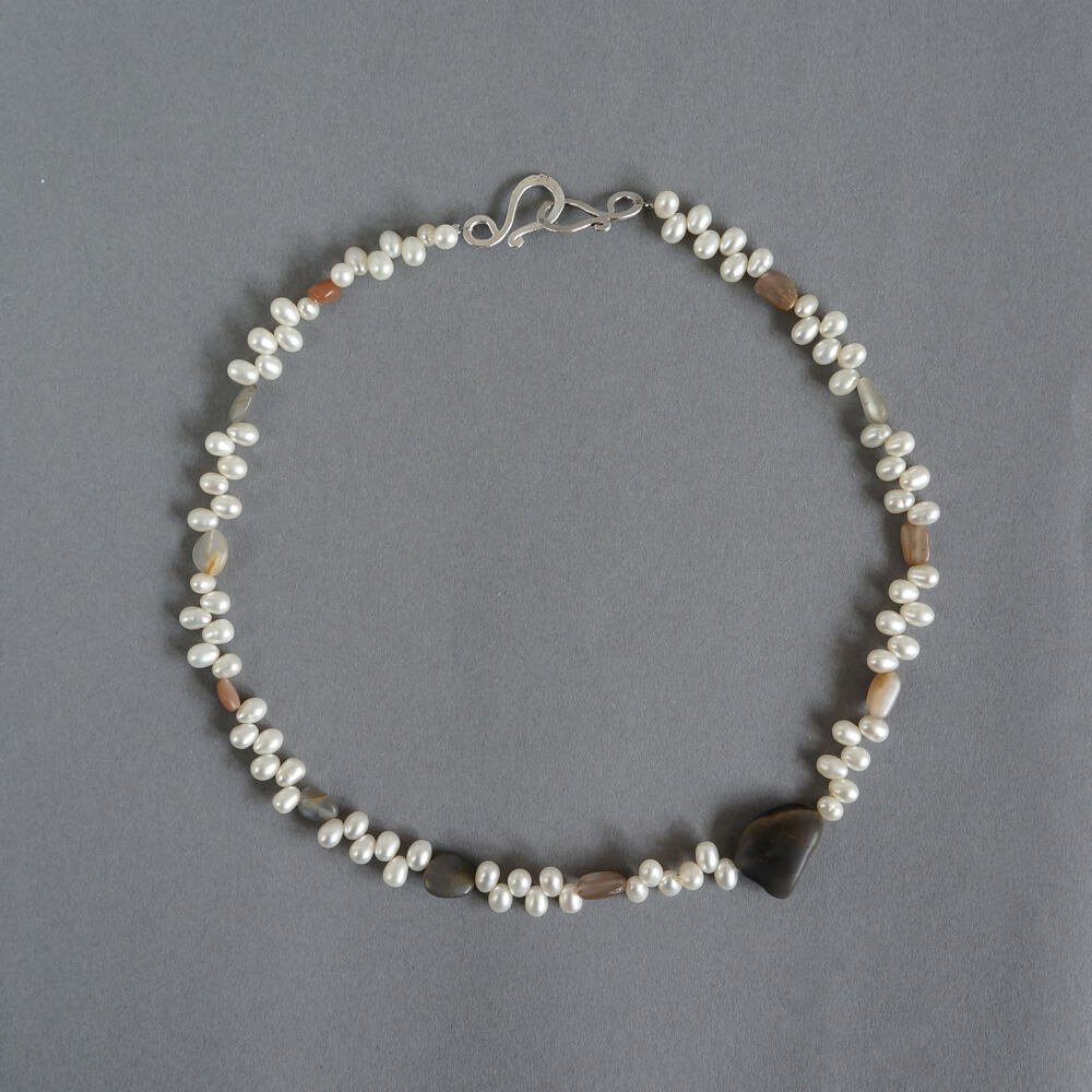 Melanie Decourcey/Beaded Necklace/teadrop shaped peals with unpolished moonstones