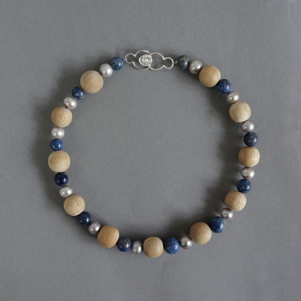 Melanie Decourcey/Beaded Necklace/wood, lapis lazuli & big grey pearls