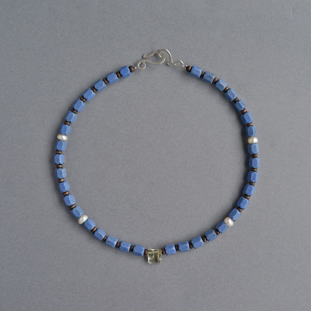 Melanie Decourcey/Beaded Necklace/blue African beads alternating with wood & pearls