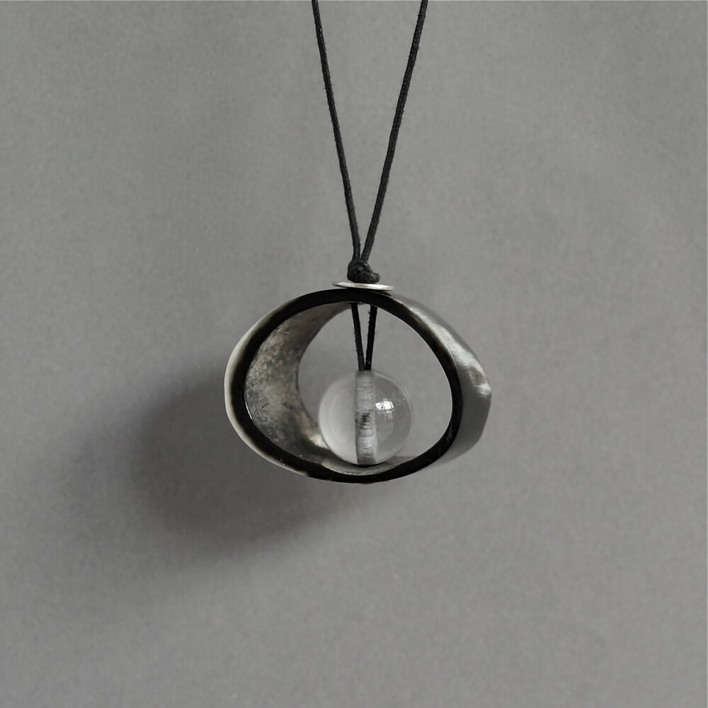 Melanie Decourcey/Necklace/round horn with crystal center & silver button