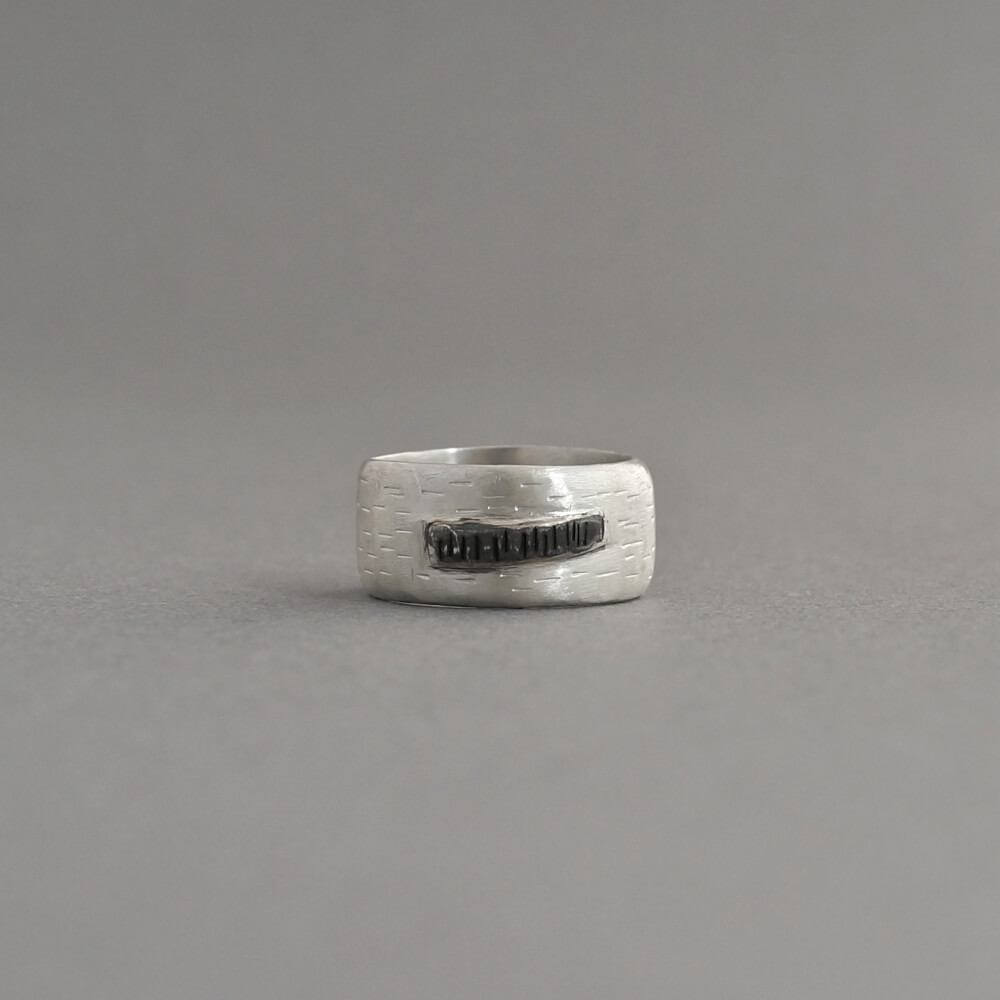Melanie Decourcey/silver ring with horizontal lines & oxidized middle line with verticals