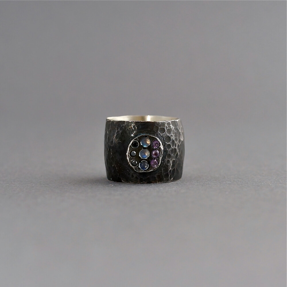 Melanie Decourcey/oxidized silver ring with round center:black diamonds,moonstones,amethyst