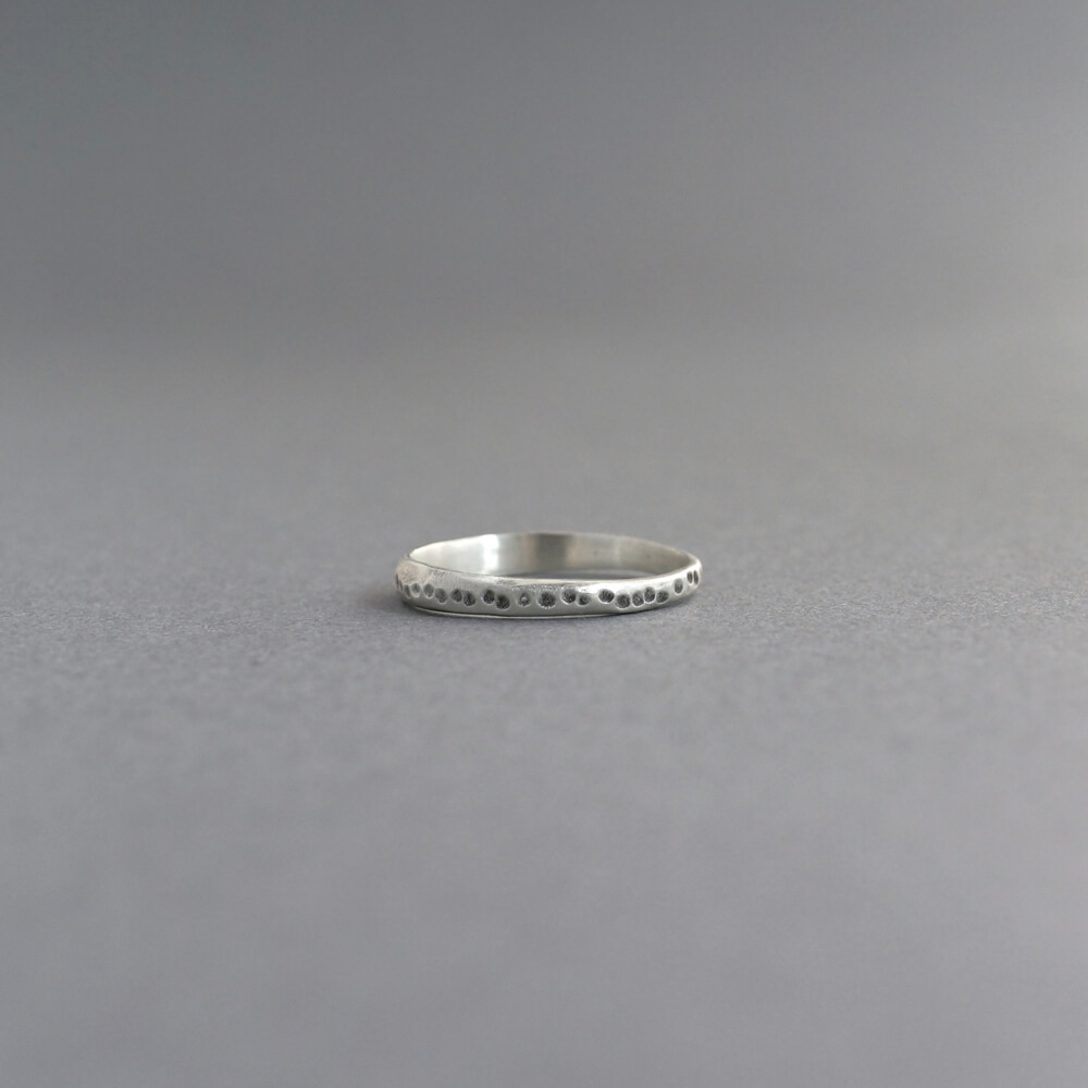 Melanie Decourcey/thin silver ring with dotted line