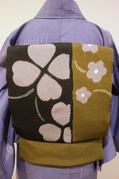 世田谷【K-4649】縮緬地 絞り染め 名古屋帯 鶯茶色×檳榔子染色 花とクローバーの図