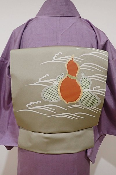 銀座【K-4757】塩瀬 染名古屋帯 淡い柳茶色 波に瓢箪の図