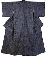 【着物2185】本場結城紬 濃藍色 亀甲地抜き幾何文 (証紙付・三越扱い)