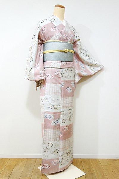 世田谷【D-1995】紬地 小紋 薄柿色×白練色 変わり段に花の図(しつけ付)
