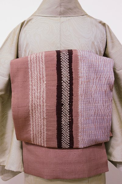 世田谷【K-5402】紬地 絞り染め 名古屋帯 蘇芳香色 四角い抽象文