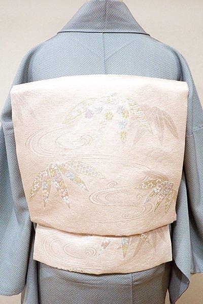 銀座【K-5508】西陣 都製 織名古屋帯 桜色 流水に笹の図(証紙付)
