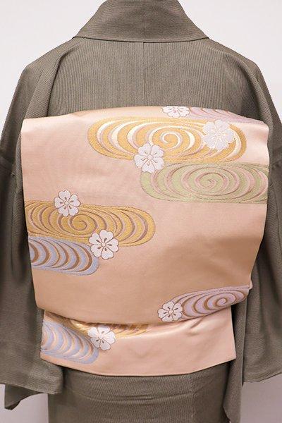 銀座【K-5650】西陣製 織名古屋帯 淡い赤香色 流水に桜の図(証紙付)
