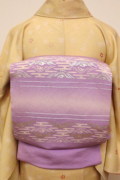 あおき【K-5853】縮緬地 染名古屋帯 藤紫色 段に向い鳳凰菱文