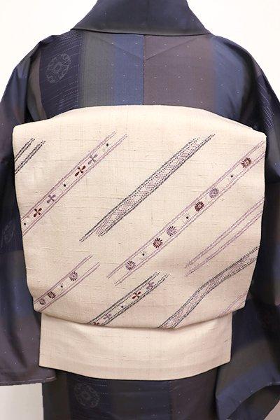 銀座【K-5890】紬地 刺繍 名古屋帯 白練色 小花の斜め縞