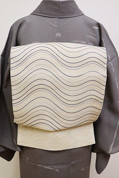 銀座【L-4468】夏 袋帯 淡い鳥の子色 波のような抽象文
