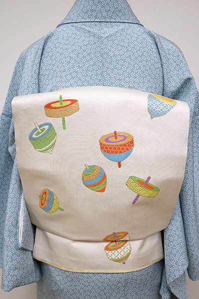 銀座【K-6498】西陣 川島織物製 織名古屋帯 生成り色 独楽の図(落款入)