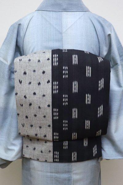 銀座【K-6529】木綿 イカット 名古屋帯 薄鼠色×墨色 幾何絣 (反端付)