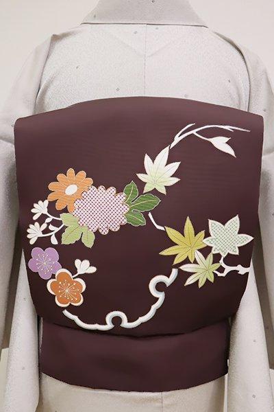 銀座【K-6575】塩瀬 染名古屋帯 煤竹色 雪輪に四季花の図