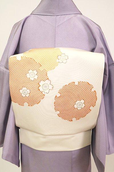 あおき【K-7345】塩瀬 染名古屋帯 生成り色 雪輪に桜の図