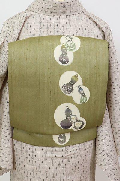 銀座【K-7409】絹芭蕉布 染名古屋帯 根岸色 丸文に瓢箪の図(反端付)