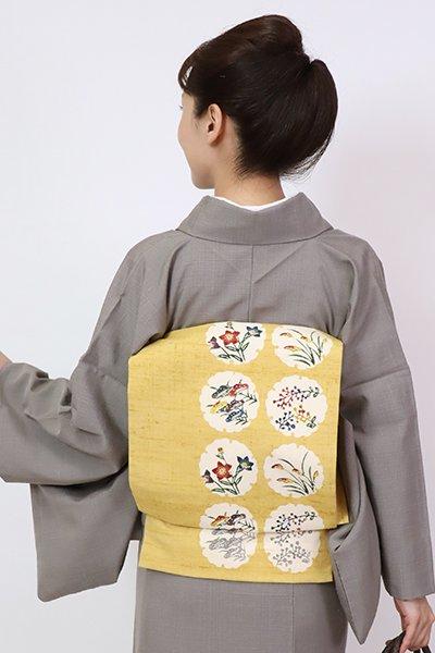 銀座【K-7808】紬地 染名古屋帯 玉蜀黍色 雪輪に四季花の図(落款入)