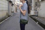 がま口の緑の革を使ったポーチ型の長財布