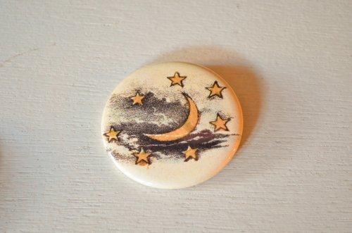 ジョンデリアンのカンバッジ 月と星