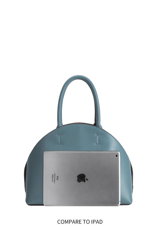 meliebiancoのAusten(Rose)ポーチ付き・ラウンドハンドバッグ/海外ファッション好きにオススメのインポートバッグとかばん、MelieBianco(メリービアンコ)のバッグやショルダーバッグ。ミニマルデザインのポーチ付きハンドバッグ。シンプルでコーデの邪魔をしない上品な雰囲気を醸し出すアイテムです。/main-20