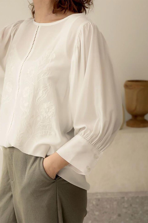 EmbroideredSatinBlouse刺繍入り・サテンブラウス大人カジュアルに最適な海外ファッションのothers(その他インポートアイテム)のトップスやシャツ・ブラウス。胸元のさりげない刺繍が可愛い7分袖のサテンブラウス。センターはしごレースを挟んでいるので高見えするアイテムです。/main-20