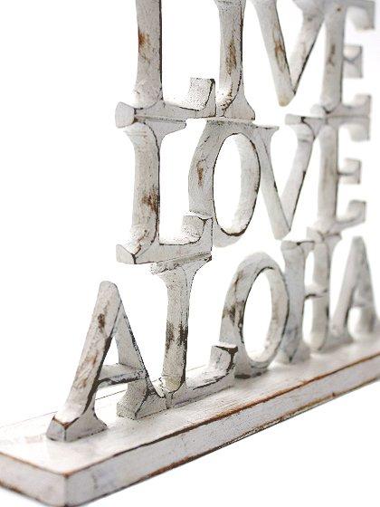 roomIVYのwoodstand(LoveLiveAloha)/ビーチでのリゾートファッションブランド、roomIVY(ルームアイビー)のインテリアや。roomIVYのデザイナーさんがセレクトしてくれたウッドスタンドです。掘りからペイントまですべて手作業で仕上げられています。/main-5